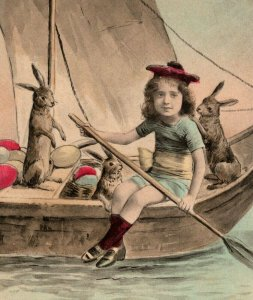 c 1905 Hand Colored Young Child Sailboat Oar Bunny Rabbits Eggs Easter Postcard
