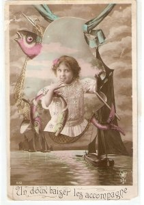 Young girl with fishes. Fishing boats Nice vintage French Greetings postcard