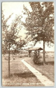 Wautoma WI~Waushara Resort~Path to Golf Course~Benches Under Shelter~1942 RPPC