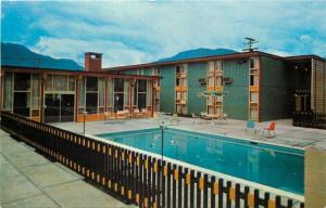 Revelstoke BC~McGregor Motor Inn~Swimming Pool Over Railing~1960s Postcard