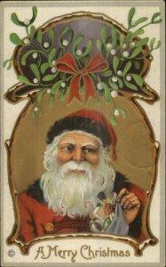 Christmas - Santa Claus Holding Stocking 1916 Used Postcard