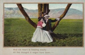 Romantic Couple Sitting In Tree And His Heart Is Beating Madly