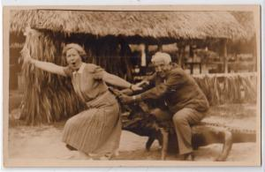 RPPC, Man on a Alligator Biting Woman in the Behind