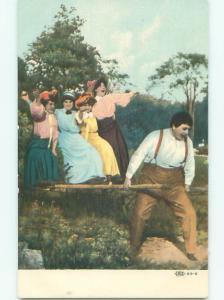 Pre-Linen MAN PULLING WOMEN ON SLED AB7998