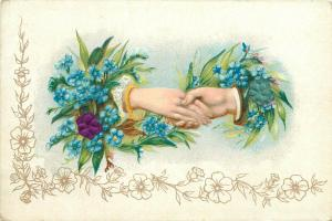 Early embossed greetings postcard floral fantasy man & lady hands fantasy