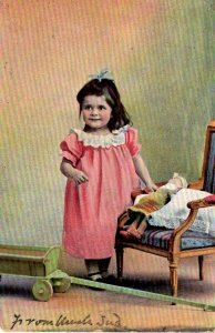 Little Girl with her doll and Wagon - in 1906