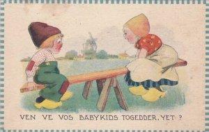 Dutch Girl & Boy Playing On See Saw 1914