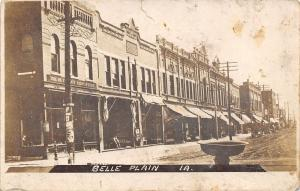 Belle Plaine Iowa~Main St~Hardware~Shopkeeper at Grocery~Horse Trough~1909 RPPC