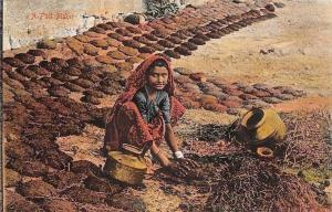 India A Fuel Maker, Girl Gathering Dirt in Vases