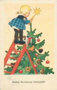 Hungary circa 1940 Christmas tree fantasy postcard girl star