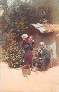Japan Old Woman and Man with Baby Tinted Real Photo Antique Postcard J81225