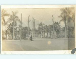 Pre-1930 rppc PEOPLE WALKING AROUND STATUE MONUMENT marked as PANAMA t3078