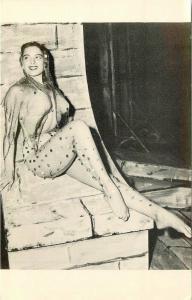 Bikini Beauty Fish Nets posing by fireplace interior 1940s Postcard Moss 962