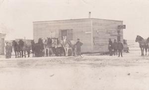 RP:FORWARD, Saskatchewan, Canada, PU-1911; Moving Doctor's Office on Main Street