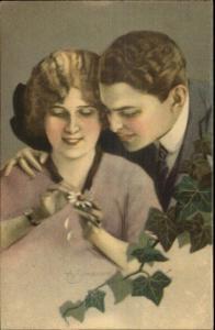 SIMEONE - Beautiful Woman Picking Daisy Petals - Romance c1910 Postcard