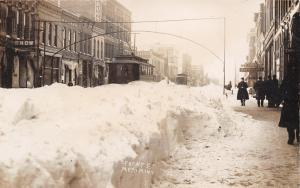 Mankato MN~Front Street~Trolley by Snow Banks~Drugs~EJ Moore~Klein Co~1909 RPPC