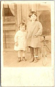 Vintage RPPC Photo Postcard Two Little Girls on House Porch TRICYCLE Bike c1920s