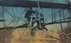 Bunched on the fly, Three people flying biplane, PU-1911