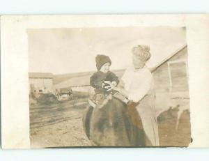 1910 rppc GRANDMA WATCHES LITTLE BOY ON HORSE BY THE BARN o2184