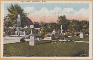 Rochester, Minn., City Park, men chatting near fountain - 1928