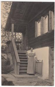 Social History; Woman in Front of Wooden House RP PPC, Unposted