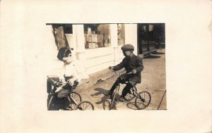 Mapleton Iowa~Victorian Boys on Tricycles in Front of Griffin Pharmacy~1915 RPPC