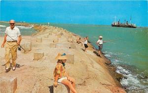 McAllen Texas~Texas Red Granite Breakwater~Fishermen~Ship~1950s Postcard