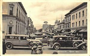 Reno NV Busy Street Scene Expensive Cars Storefronts Real Photo Postcard.