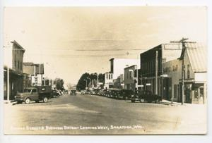 Saratoga WY Bridge Street Store Fronts Old Cars RPPC Real Photo Postcard
