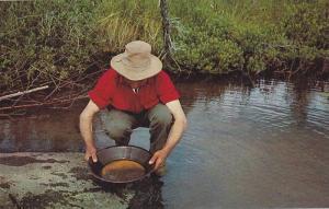 Louie Garskie, Panning gold at his one-man mine near Yellowknife, N.W.T.,  Ca...