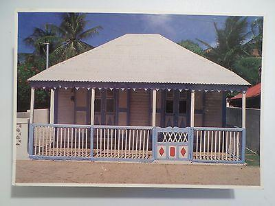 POSTCARD & STAMP YEAR 1993 GUADELOUPE TYPICAL HOUSE MAISO...