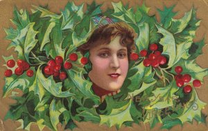 NEW YEAR, 1900-10s; Greetings, Woman's face framed by holly, Gold background