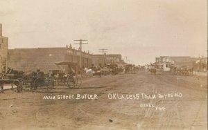 RP: BUTLER , Oklahoma , 1900-10s ; Main Street (dirt)