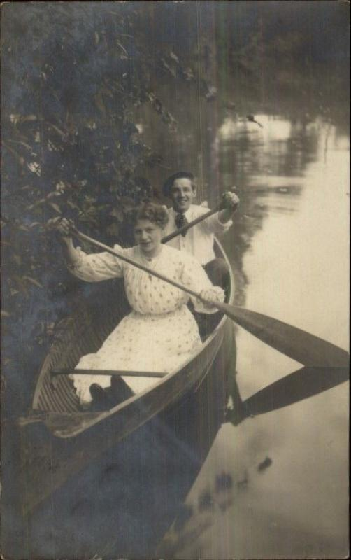 Man & Woman in canoe Canoeing c1910 Real Photo Postcard
