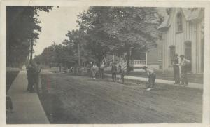 Road Work~Crew of Men Digging With Pick Axes Along Street~Boys Watch~1908 RPPC