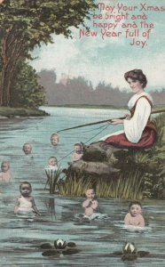 CHRISTMAS & NEW YEAR, 1900-10s; Woman fishing for babies in the river