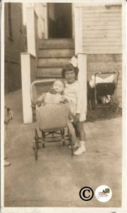 Small Photograph of Little Girl with doll/Dolly In Baby Carriage Wicker Doll Bug