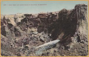 How they cut down hills in Seattle, WASH. Early view of Hydro Mining