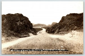 Grand Coulee WA~North End on Dirt Rd Through Cut to Dam~1930s RPPC by Tillquist