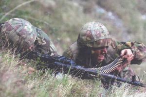 Army Soldiers in Fatigues & Helmets Firing Machine Gun from Ground, PC #17