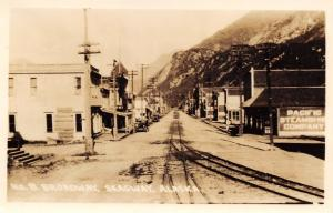 Skagway AK Sleigh on Trolley Tracks~Pacific Steamship Sign~Cigar Store~RPPC 1925