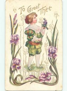 Pre-Linen BOY HOLDS UP PURPLE AND WHITE FLOWERS W7154