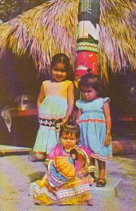 Seminole Children In Colorful Dress At Tropical Gardens Miami Florida