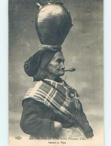 Pre-Linen WOMAN WITH JUG ON HEAD SMOKES PIPE AT MORLAIX COMMUNE IN FRANCE HL7693