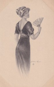 AS: Pretty woman in dark gown holding hand fan looking over shoulder, 1900-10s