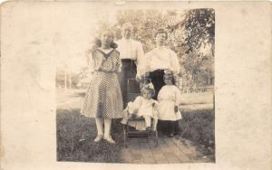 Council Bluffs Iowa (?)~Family Portrait~Little Girl in Baby Carriage~1908 RPPC