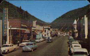 Coeur D'Alene Bank St. c1950 Old Cars & Store Signs Postcard