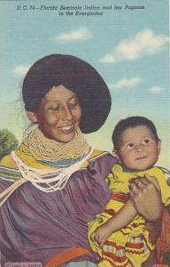 Florida Seminole Indian and her Papoose in the Everglades