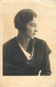 Postcard Glamorous woman portrait fancy coiffure elegant black coat