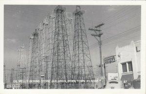 RP: KILGORE , Texas , 1930-40s ; Oil Wells Behind Store Building